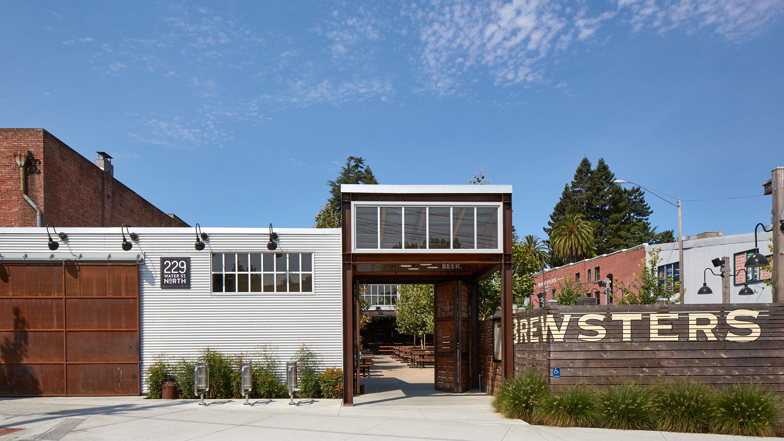Petaluma-Restaurant-Design-Brewsters-outbuilding-with-exposed-steel-structure-and-corten-steel-barndoor