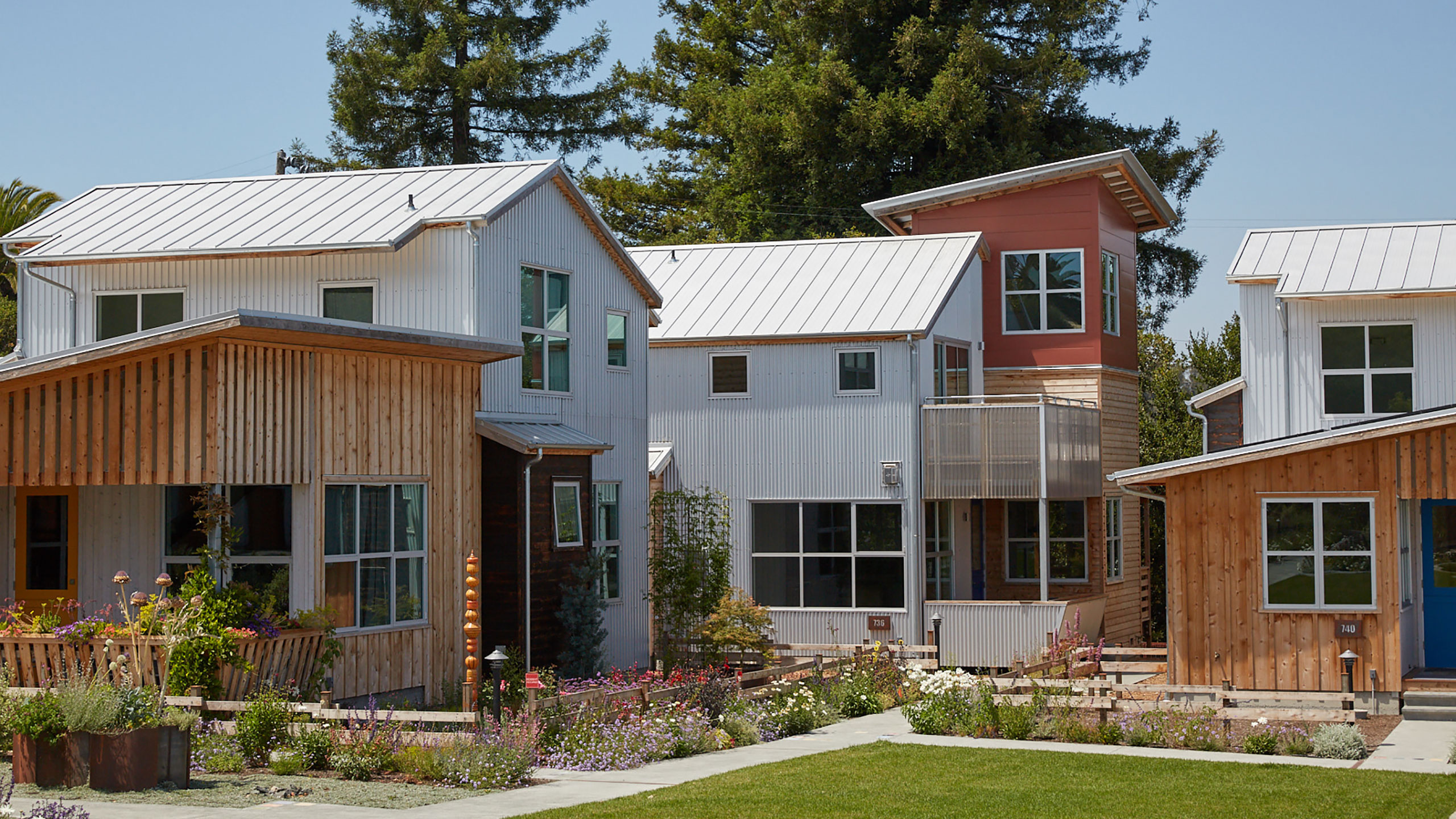 Sustainable-Architecture-Sonoma-County-Keller-Court-exterior-view-of-houses-with-corrugated-metal-siding-and-towers