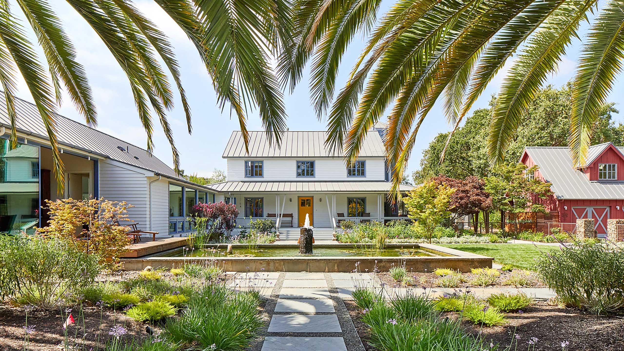 Napa-Farmhouse-palm-trees-houses-around-courtyard