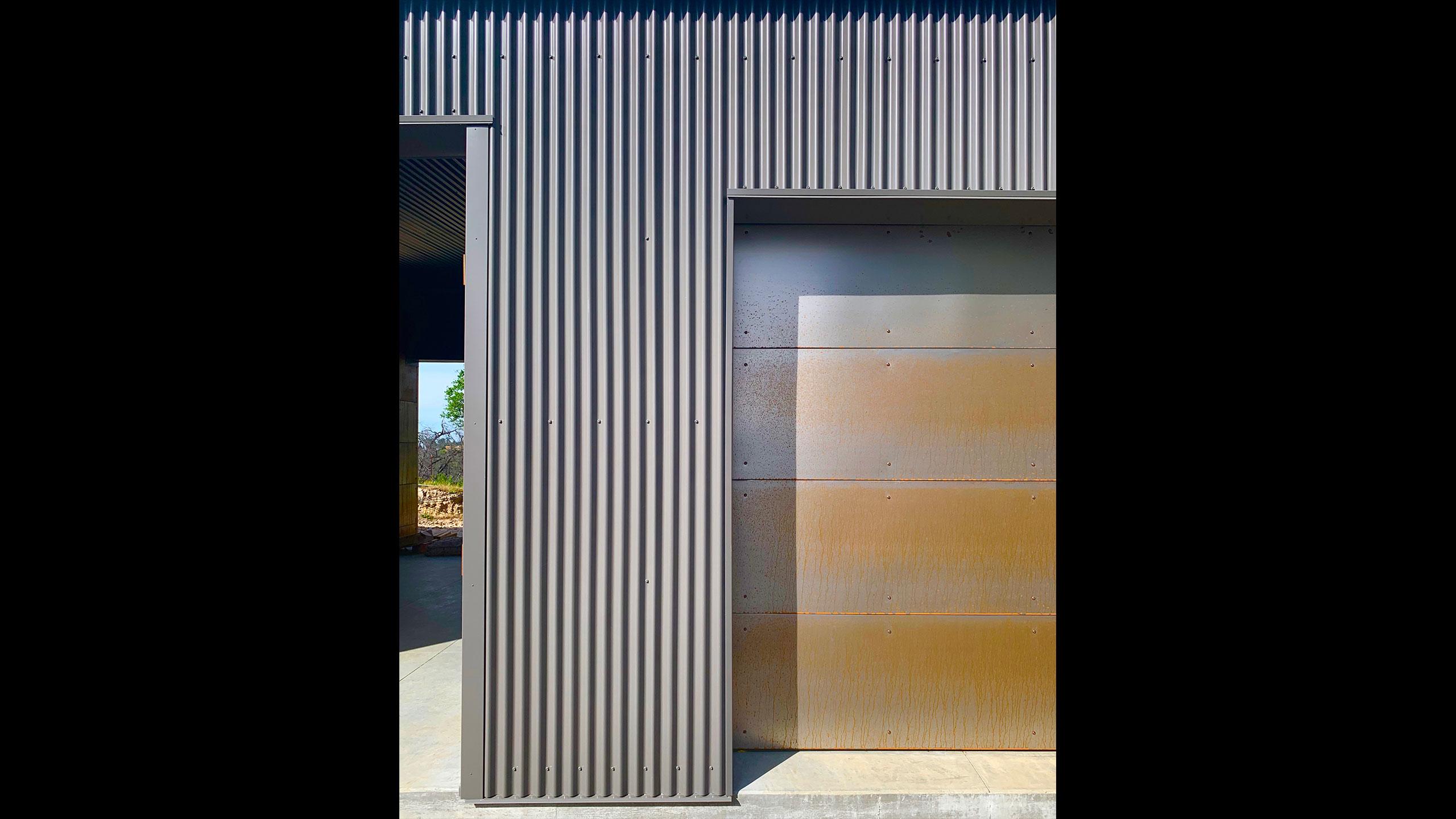 Glen-Ellen-metal-prefab-corten-steel-garage-door-and-corrugated-metal-facade