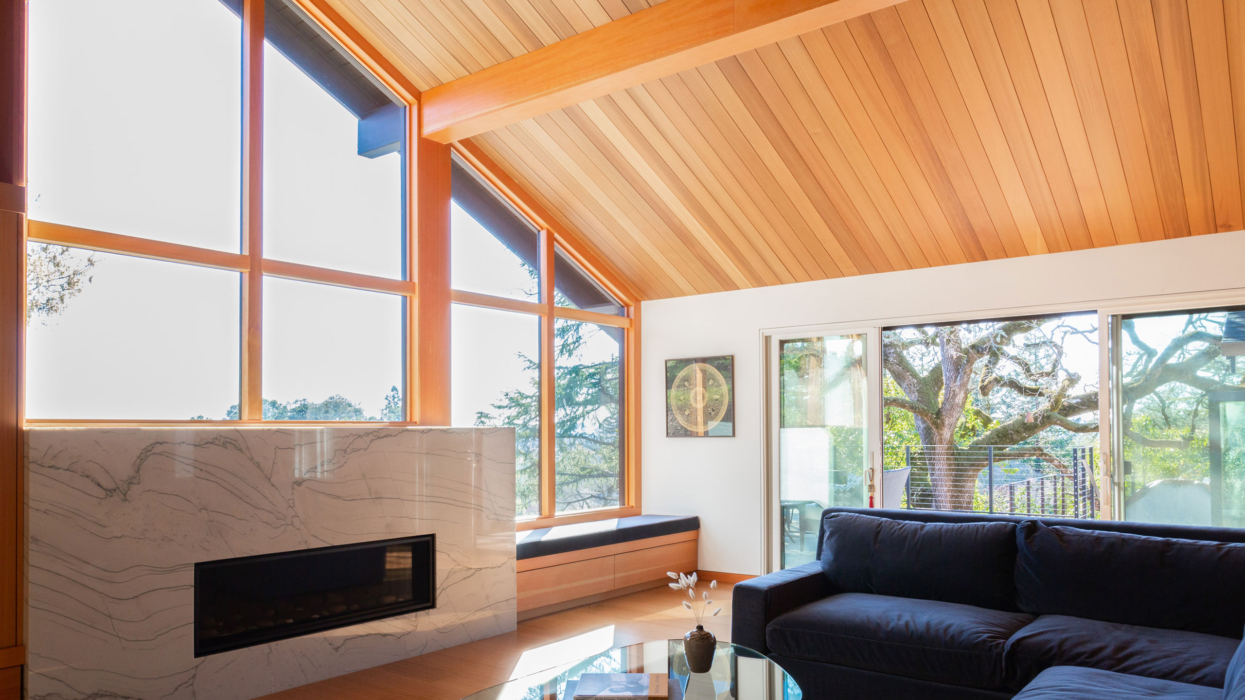 Zen-House-Santa-Rosa-marble-fireplace-bright-wood-windows-and-ceiling
