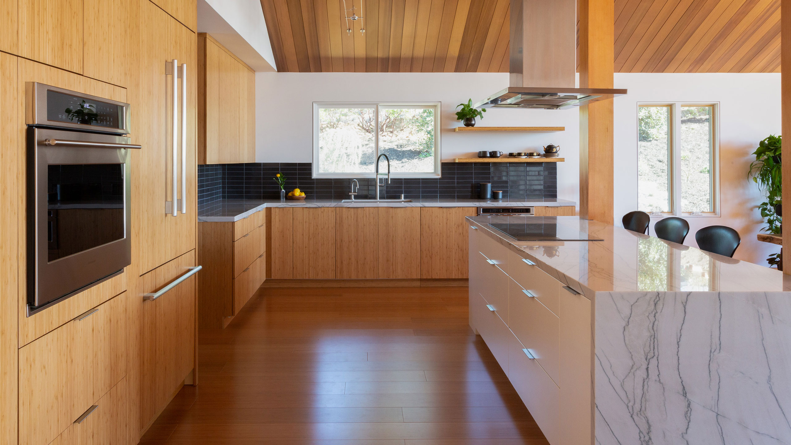 Zen-House-Santa-Rosa-modern-wood-kitchen-with-marble-island-and-black-tile
